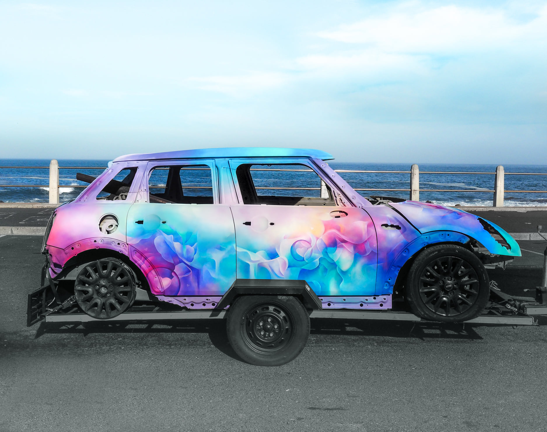 Torched Mini Cooper turned into colourful mobile artwork