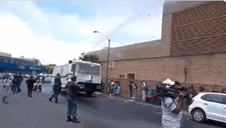 """Watch: SAPS spray elderly, disabled at SASSA offices in Bellville as a """"measure to enforce social distancing"""""""