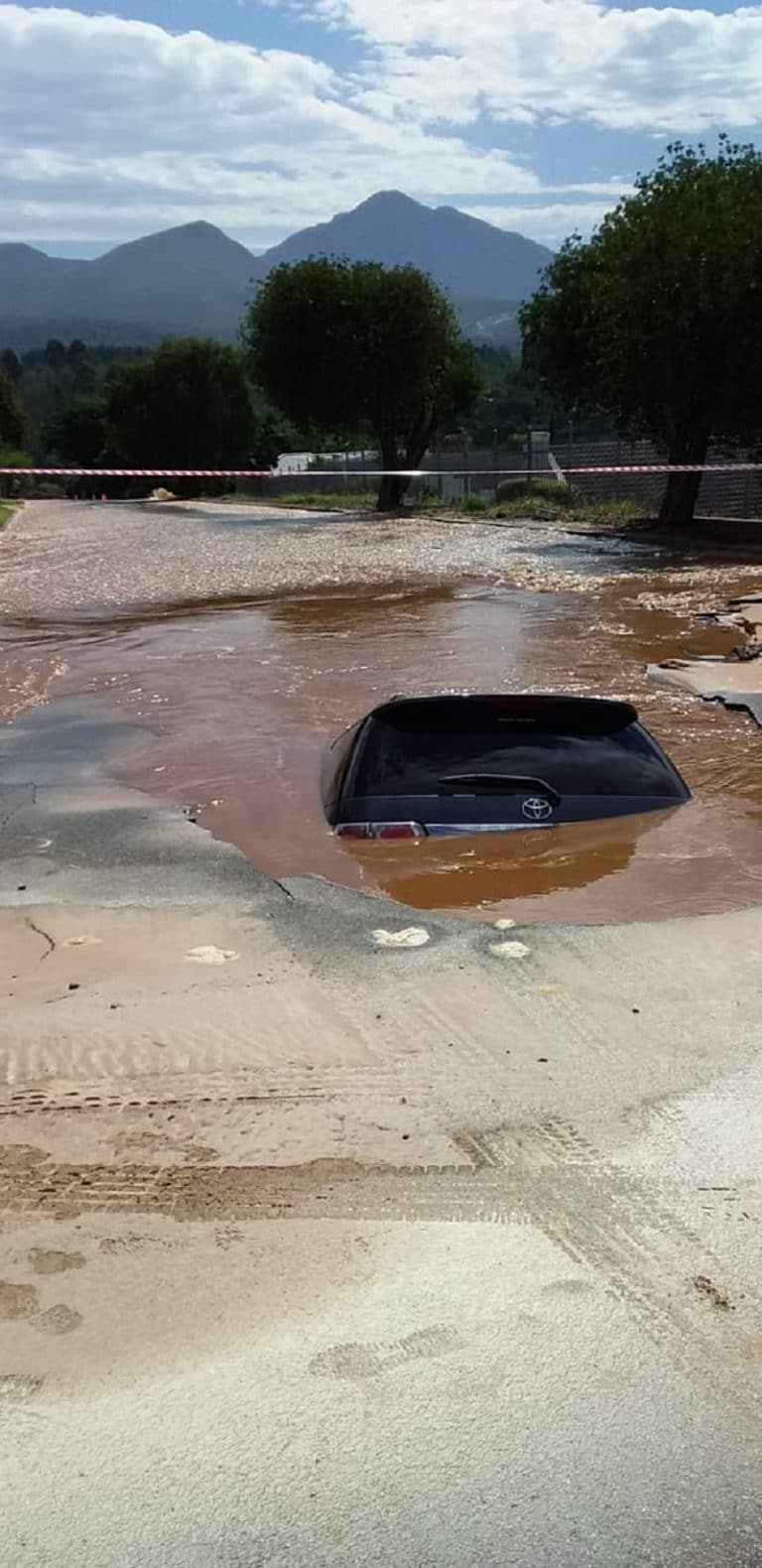 Father, son safely escape after car falls into massive sinkhole in George