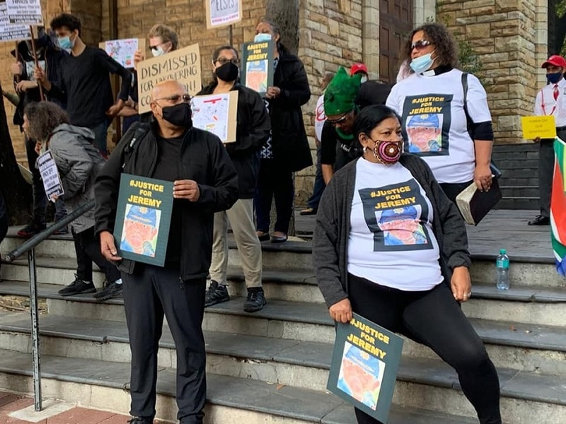 Protesters march to Parliament in support of Jeremy Vearey
